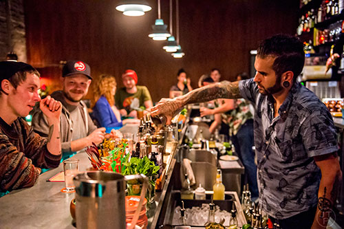 Photo: Jonathan Phillips Tending bar at S.O.S. Tiki Bar in Decatur.